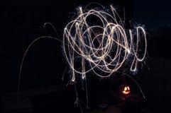 Het lichte schilderen met sterretjes - squiggles in kleur stock fotografie