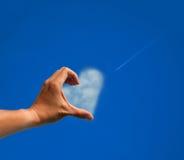Het liefdesymbool door hand Stock Afbeeldingen