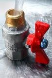 Het loodgieterswerk van de kraan met een rode pen Royalty-vrije Stock Afbeelding