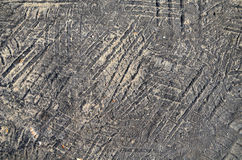 Het loopvlakafdruk van de band in asfalt Stock Afbeeldingen