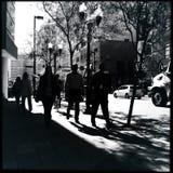 Het lopen aan het werk Stock Foto