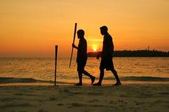 Het lopen bij zonsondergang royalty-vrije stock foto