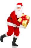 Het lopen de Kerstman van Kerstmis Stock Foto's