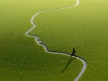 Het lopen op een gezicht-vormige weg Stock Fotografie