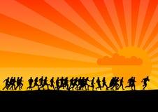 Het lopen van de zonsondergang Stock Fotografie