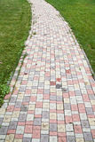Het lopen van steeg van gekleurde tegel Stock Foto