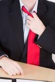 Het losmaken van een rode band Stock Afbeelding