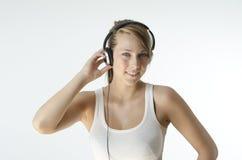 Het luisteren aan muziek Stock Afbeeldingen