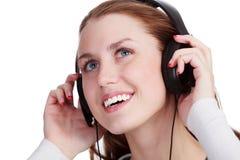 Het luisteren aan Muziek Stock Foto's