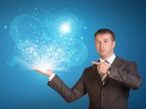 Het magische licht van de bedrijfsmensengreep ter beschikking Stock Fotografie