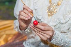 Het maken en het schilderen khanom lookchoup Royalty-vrije Stock Foto