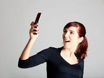 Het maken van een telefoongesprek Stock Foto