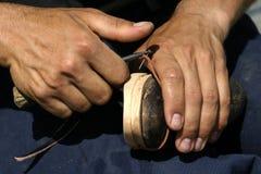 Het maken van schoenen stock afbeeldingen