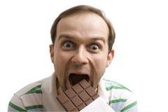 Het maken ziet terwijl het eten van chocolade onder ogen royalty-vrije stock foto's
