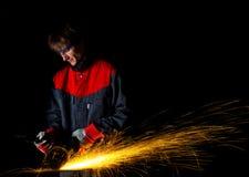 Het malende ijzer van de arbeider Stock Foto