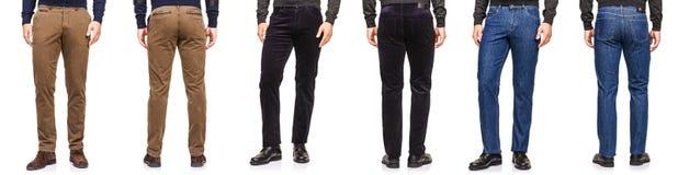 Het manierconcept met broeken op wit Stock Foto