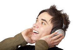 Het mannelijke luisteren van de Tiener aan muziek en zingt luid stock fotografie