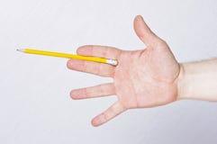 Het mannelijke potlood van de handholding Stock Afbeelding