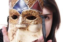 Het masker dat zijn gezicht verbergt Stock Afbeelding