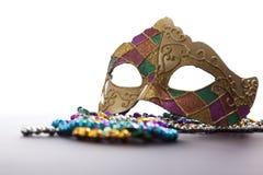 Het Masker en de Parels van Gras van Mardi Stock Foto's