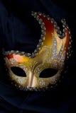 Het masker, het goud en het rood van Venecian Stock Afbeeldingen