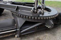 Het massieve toestel van het roterende mechanisme van het blad op een tractor stock fotografie