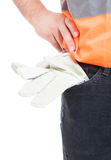 Het materiaal van de close-uptechniek met oranje vest en handschoenen in po stock foto