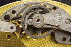 Het mechanisme van de close-up van oud horloge royalty-vrije stock afbeelding