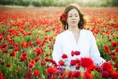 Het mediteren van de vrouw Stock Afbeelding