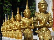 Het mediteren van uddhas in lijn Stock Afbeelding