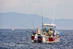 Het Meer Champlain van de Visserij van de sport met Downriggers stock afbeeldingen