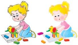 Het meisje beeldhouwt een stuk speelgoed olifant Royalty-vrije Stock Fotografie
