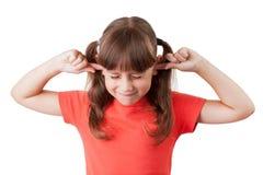Het meisje behandelde zijn oren stock afbeeldingen