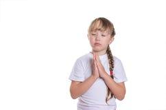 Het meisje bidt stock afbeelding