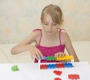 Het meisje bouwt bouw Royalty-vrije Stock Afbeeldingen