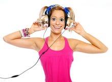 Het meisje dat een muziek luistert. Royalty-vrije Stock Foto