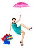 Het meisje dat op paraplu is gevlucht stock foto