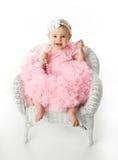 Het meisje dat van de baby pettiskirt tutu en parels draagt Stock Fotografie