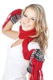 Het meisje dat van de blonde de winterkleding op wit draagt Stock Afbeelding
