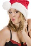 Het meisje dat van de Kerstman gezicht maakt royalty-vrije stock fotografie