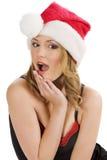 Het meisje dat van de Kerstman grappig gezicht maakt Stock Foto's