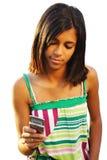 Het meisje dat van de tiener sms typt stock afbeeldingen