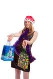 Het meisje dat van Sants een gift aanbiedt Stock Foto's