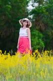 Het meisje in de hoed Stock Foto