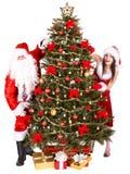 Het meisje, de Kerstman en de spar van Kerstmis. Stock Foto's