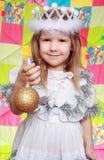 Het meisje in de kleding van een Nieuwjaar Stock Afbeelding