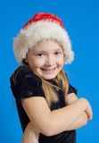 Het meisje de tiener in de hoed van de Kerstman stock fotografie