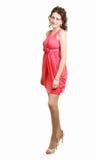 Het meisje die van de schoolmeisjemiddelbare school koraalavondjurk voor prom in middelbare school dragen. Een gediplomeerde van d Stock Foto's