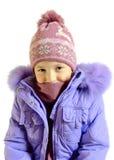 Het meisje in een blauw warm jasje royalty-vrije stock afbeelding