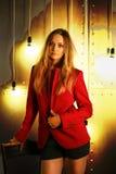 Het meisje in een jasje en borrels Royalty-vrije Stock Foto